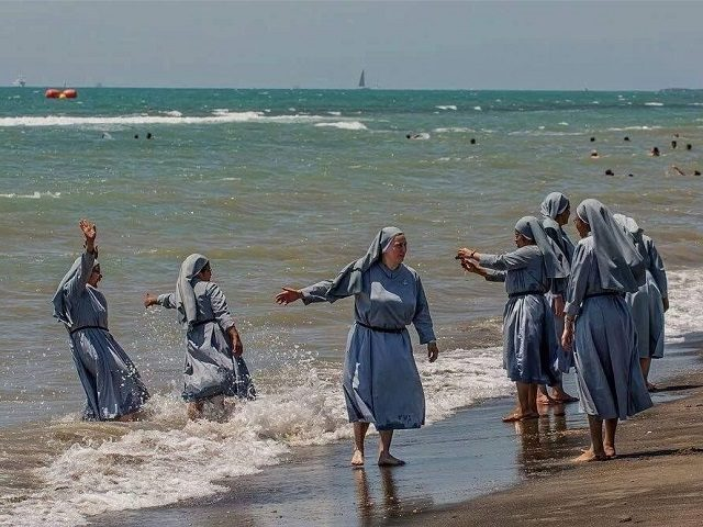 Nuns-on-beach-640x480
